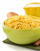 corn flakes in bowl isolated on white background