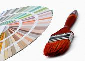 Close-up of a color palette and a brush ,isolated on white background