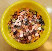 Heap Of Coins In Yellow Bowl
