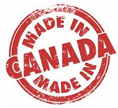 Made in Canada  words on a red round stamp to show pride in goods, products and services produced or