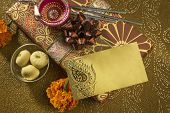 A diwali gift set up with an empty message tag.