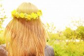 Female hair with crown of dandelions