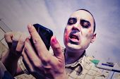a scary zombie using a smartphone, with a filter effect