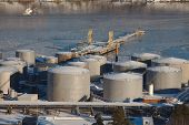 Big oil silos in a dock