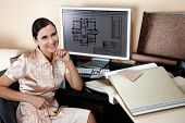 Smiling female interior designer at her workplace