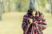 stock photo of cigarette lighter  - Young brown hair woman in wrap with cigarette and lighter - JPG