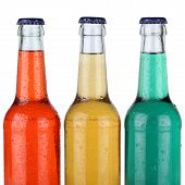 Colorful Soft Drinks Or Lemonade In Bottles Isolated