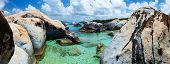 Panorama of The Baths beach area major tourist attraction at Virgin Gorda, British Virgin Islands with turquoise water and huge granite boulders, perfect for banners