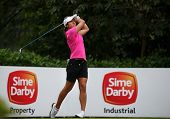KUALA LUMPUR, MALAYSIA - OCTOBER 11, 2014: Marina Alex of the USA tees off at the fourth hole of the KL Golf & Country Club during the 2014 Sime Darby LPGA Malaysia golf tournament.