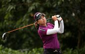 KUALA LUMPUR, MALAYSIA - OCTOBER 11, 2014: Thidapa Suwannapura of Thailand tees off at the fourth hole of the KL Golf & Country Club during the 2014 Sime Darby LPGA Malaysia golf tournament.