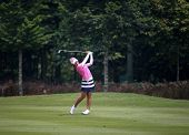 KUALA LUMPUR, MALAYSIA - OCTOBER 10, 2014: Mi Hyang Lee of South Korea plays on the fairway of the ninth hole of the KL Golf & Country Club at the 2014 Sime Darby LPGA Malaysia golf tournament.