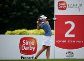 KUALA LUMPUR, MALAYSIA - OCTOBER 11, 2014: Austin Ernst of the USA tees off at the second hole of the KL Golf & Country Club during the 2014 Sime Darby LPGA Malaysia got tournament.