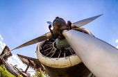 Engine And Propeller Of Vintage Aircraft Against Blue Sky