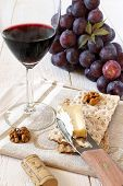French Soft Cheese Brie, Red Grapes And Glass Of Red Wine