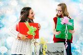 Girls Giving Presents At Christmas.