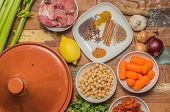 picture of tagine  - Ingredients for a Moroccan tagine dish with chick peas lamb carrots celery lemon onion cinnamon star anise - JPG