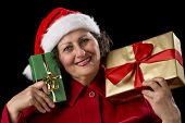 Smiling Lady With Golden And Green Christmas Gifts.