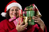 Happy Female Senior Lifting Many Wrapped Presents.