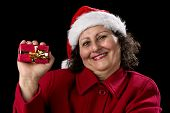 Happy Aged Woman Presenting Red Wrapped Xmas Gift.