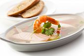 Seafood Aspic topped with Shrimps. Garnished with Bread