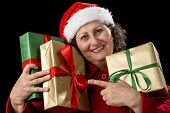 Elderly Woman With Three Wrapped Christmas Gifts.