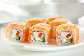 Roll with Cream Cheese, Salmon roe and Cucumber inside. Salmon outside