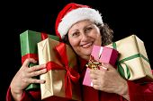Smiling Aged Woman Embracing Four Wrapped Gifts.