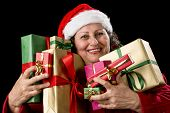 Joyful Senior Woman Hugging Eight Wrapped Gifts.