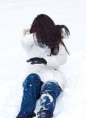 Young Girl Playing In The Snow.