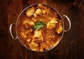 picture of curry chicken  - overhead photo of a batli dish with indian butter chicken curry - JPG