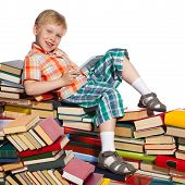 Little Boy On A Pile Of Books