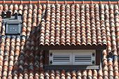 Dormer Window Shuttered In A Tile Roof, Horizontal