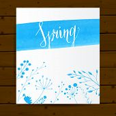 Vector card template with blue paint stroke, hand drawn calligraphy word spring and plants with leav