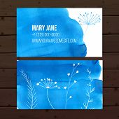 Creative business card template with blue watercolor paint background and white leaves and plants gr