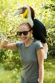 Exotic bird on a womans shoulder