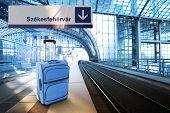 Departure For Szekesfehervar, Hungary. Blue Suitcase At The Railway Station