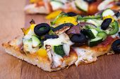 vegetable homemade rustic pizza closeup on wood table