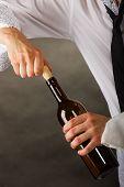 Man Opening Bottle Of Wine