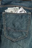 Us Dollars And Condom In The Jeans Pocket