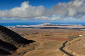 picture of canary-islands  - view at Valle del Pozo from the 450m high at Femes Lanzarote Island Canary Islands Spain - JPG