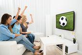 Three Women Watching Football Match