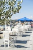 image of greeks  - Typical greek restaurant and fish boat on the background - JPG