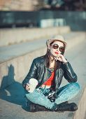 Young Fashion Hipster Beautiful Girl In Leather Jacke With Retro Camera