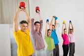 Happy People Exercising With Kettle Bell