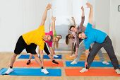 Happy People Exercising At Gym