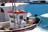 Spanish fishermen on boat.