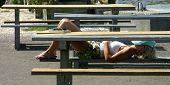 Girl resting on bench2