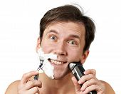Man Shaving With Razors