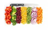 picture of knife  - Cut colorful vegetables in line with knife on white background - JPG