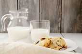 Cookies With Milk On Wooden Background